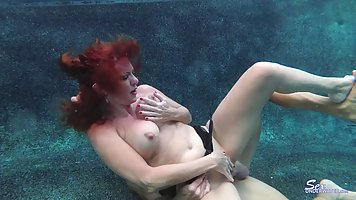 Redhead wife with big milkings does Blowjob to her husband under water
