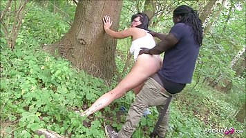 The Negro took a brunette on the nature and gave her a great sex in the pose of ...