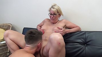 Mature lady alone with stepson seduced him into sex on the couch