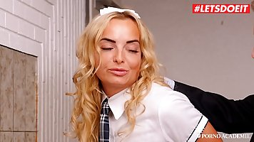 Blonde in uniform substitutes a slit for double penetration and anal