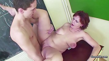 Mature nurse spreads her legs in front of the young student in College on the ta...