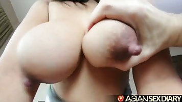 Asian with big Tits in different poses fucking with a guy