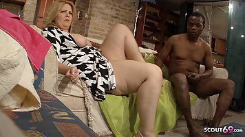 Fat woman with big milkings has sex with a black man