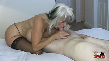 Mature woman in stockings spread her legs for a spanking with a young boy