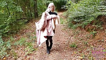 Blonde in the forest Blowjob and takes the cum