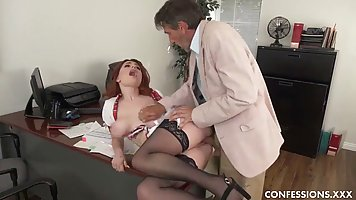 Redhead girl with big ass spreads her legs in stockings for sex with the boss
