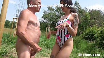 Young brunette outdoors Blowjob old man and brings him to orgasm
