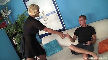 Blonde mommy spreads legs in stockings before a hard cock of a young guy