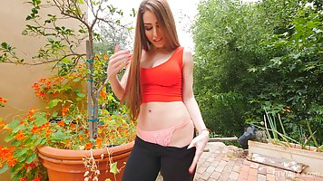 Girl with big milkings solo in the garden and shows off Frank erotic show