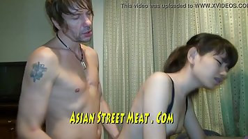 A man put an Asian at home with a doggy style and fucked a big cock in a narrow ...