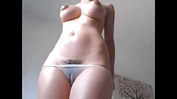 Webcam beauty stroking hairy clit and big standing tits