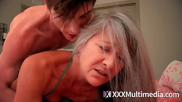 The boy takes off his burgundy panties and has an old woman in bed for a long ti...
