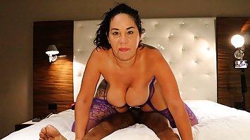 The Negro rubs his big-tit Latina wife a big vagina with a fat cock