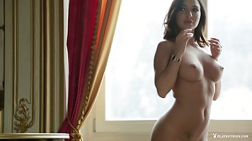 Beautiful brunette with sticking Tits posing naked and gently caressing themselv...