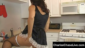 Brunette in a maid's uniform gets fucked in the kitchen with his master