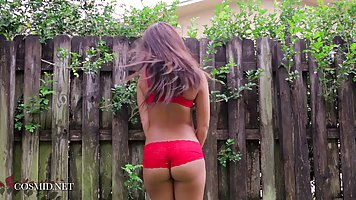 Country girl at the fence shows the beautiful erotica